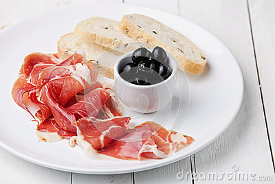 Slices of ham, Black olives and ciabatta