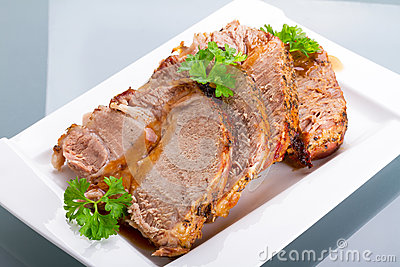 Slices of homemade roast pork on plate