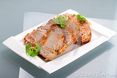Slices of homemade roast pork with reflection