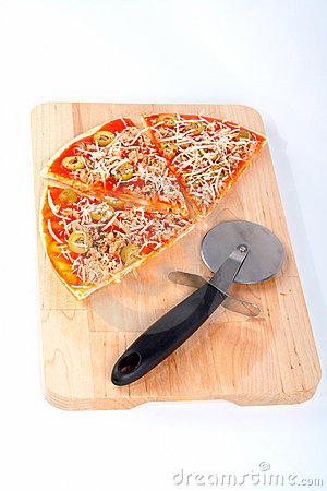 Slices of Italian pizza and cutter