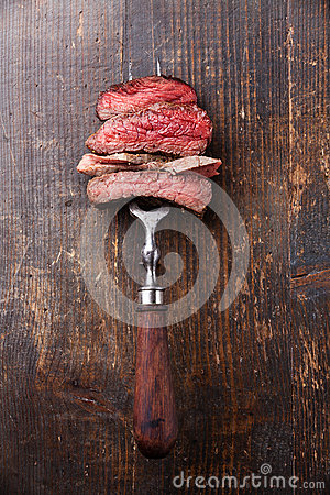 Free Slices Of Beef Steak On Meat Fork Stock Image - 38274311
