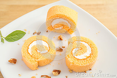 The slices of orange roll cake