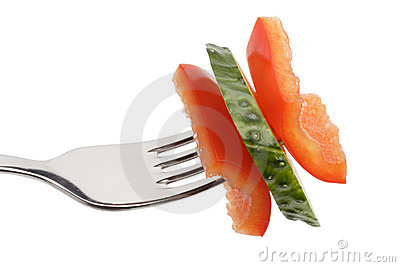 Slices of sweet pepper and cucumber on a fork