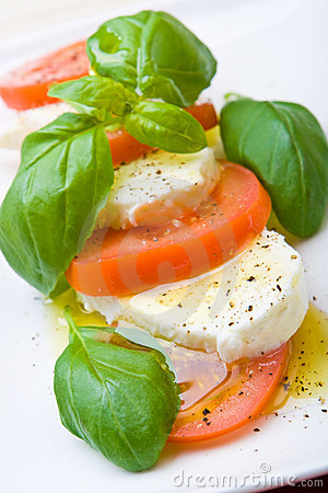 Slices of tomato and mozzarella