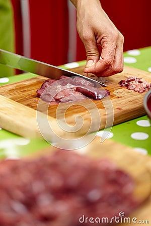 Slicing chicken liver
