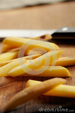 Slicing Potatoes on a Cutting Board