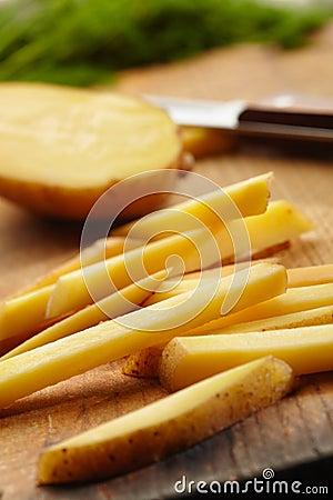 Slicing Potatoes on a Cutting Board