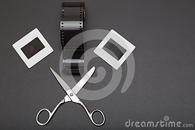 Slide , reversal film and scissors with copy space Stock Photo