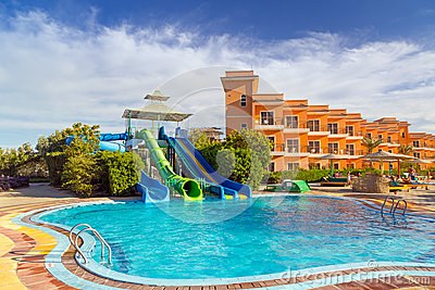 Slides at swimming pool of tropical resort in Hurghada
