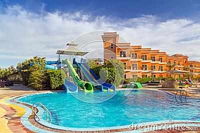 Slides at swimming pool of tropical resort in Hurghada