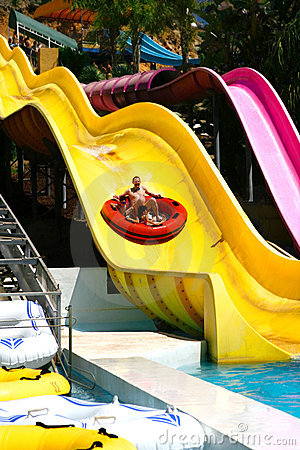 Sliding down the big slide.