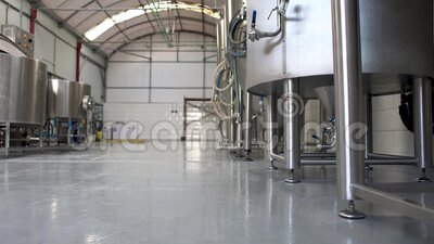 Sliding shot of craft beer brewery interior stock footage