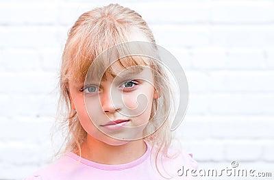 Slightly smiling little blond beautiful girl
