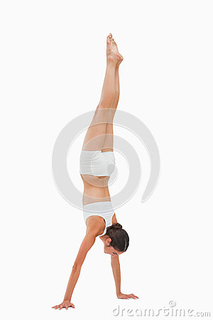 Slim brunette handstands