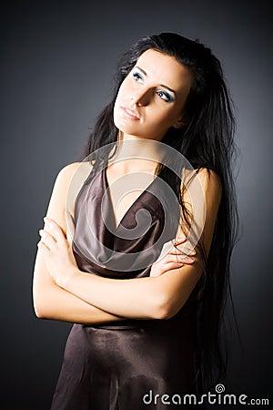 Slim brunette woman looking aside
