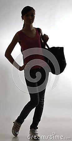 Slim girl with a bag