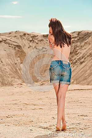 Slim girl in denim shorts posing