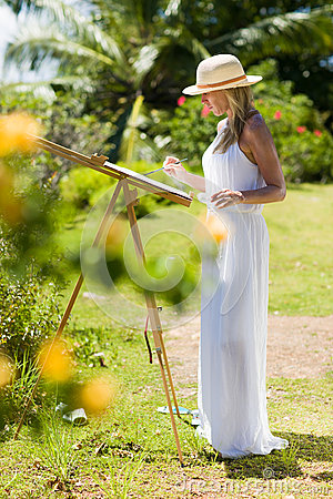 Free Slim Painter Woman In White Dress And Hat In Tropical Environment Stock Images - 69021504