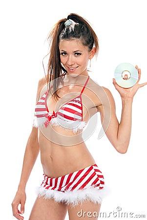 Slim sexy woman in christmas new year bikin