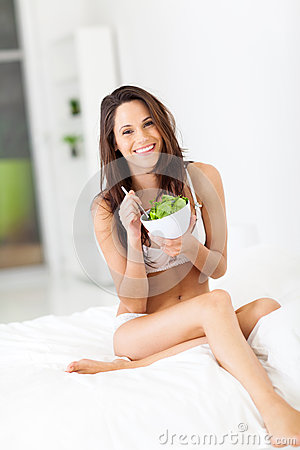 Slim woman eating