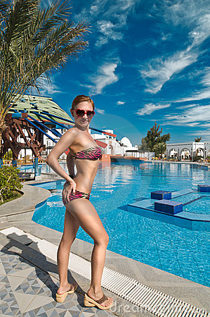 Slim woman near pool