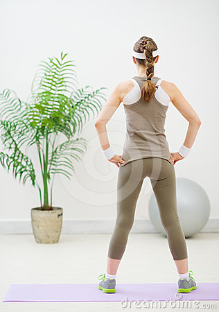 Slim woman standing back to camera