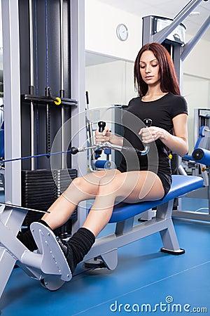 Slim woman training in a gym