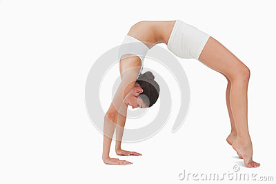 Slim woman in yoga position