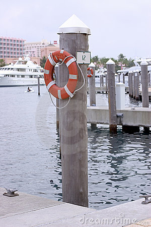 Free Slip 12 - Boat Dock With Life Saver Royalty Free Stock Images - 1909029