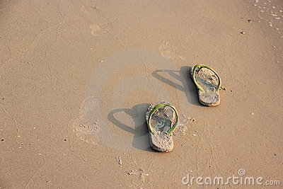 Slippers in the sand.