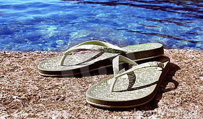 Slippers at the sea coast