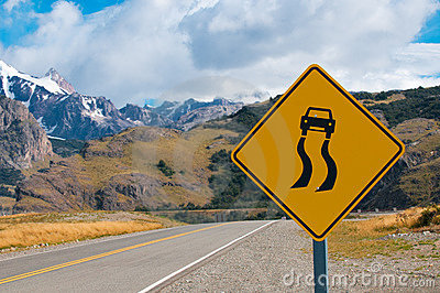 Slippery when wet warning road sign