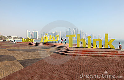 Slogans Realize and Think in Doha Editorial Photo
