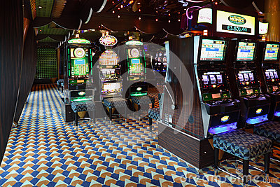 Slot machines in casino at liner Costa Luminosa Editorial Photo