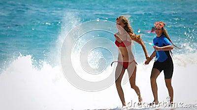 Slow motion children run by sea on beaches sea sand stock footage