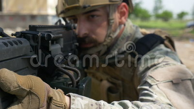 Slow motion closeup of a soldier and his military gun during a special training exercise. Slow motion closeup of soldier and his military gun during special stock video footage