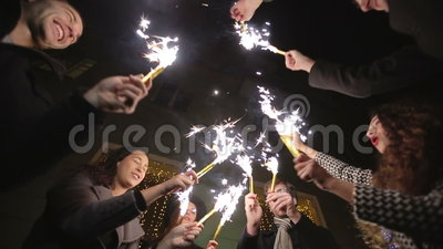 SLOW MOTION: Friends with sparklers dancing.