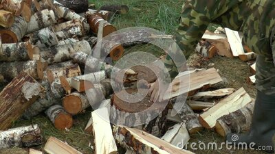 Slow motion Full HD footage of a man choping firewood with axe stock video footage
