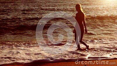 Slow motion sepia walking in morning on beaches sea sand stock video footage