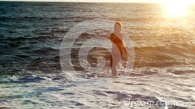 Slow motion woman jogging in morning on beaches sea sand stock video