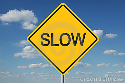 Slow Traffic Sign with clouds