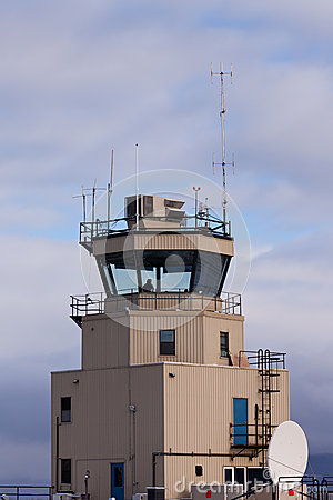 Small air traffic control tower man behind glass