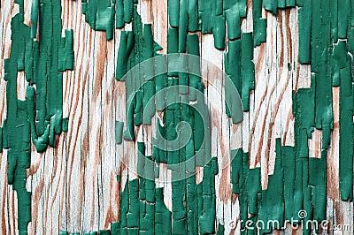 Small area of peeling paint on wood
