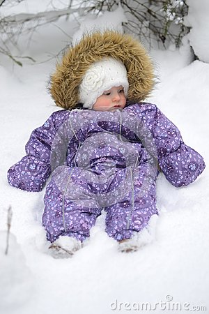 Free Small Baby Girl In The Snow Royalty Free Stock Image - 105635256