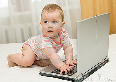Small baby and laptop on bed at home #3