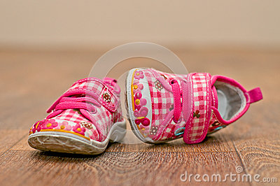 Small baby s shoes on the floor