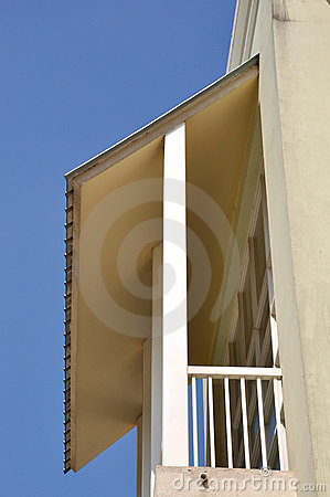 Small balcony with shield under blue sky