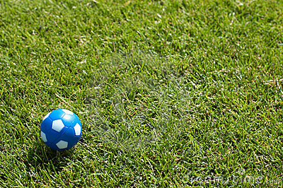Small ball on green soccer field