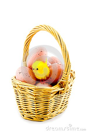 Small basket with eggs and a eastern chicken