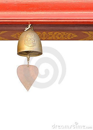 A small bell hanging under the temple roof